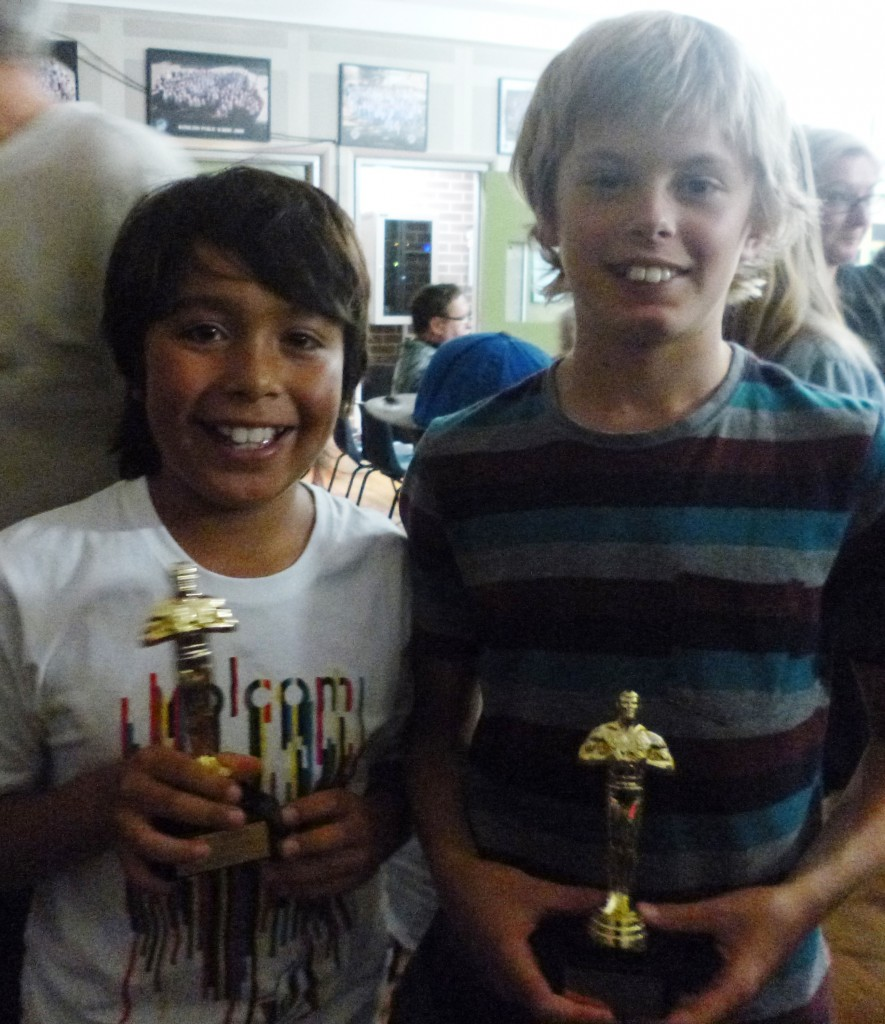 Allan and Mitch accepting their mini Oscars on behalf of their group.